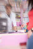 Client paying with credit card in pharmacy Stock Photo