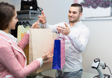 Client paying for new apparel at store Royalty Free Stock Photography