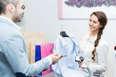 Client paying for new apparel at store Royalty Free Stock Image