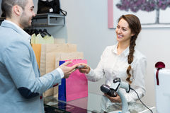 Client paying for new apparel at store Stock Photography