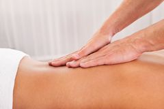 Client relaxing in massage parlor Stock Photo