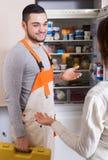 Client and repairman near fridge Stock Photography