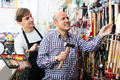 Client and salesman at tooling section Royalty Free Stock Photography