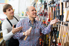 Client and salesman at tooling section Stock Photos