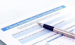 Client satisfaction evaluation form. Fountain pen is on paper, close-up photography, the image is assembled from multiple images Royalty Free Stock Photography