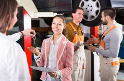 Client satisfied with mechanics renewal Stock Image