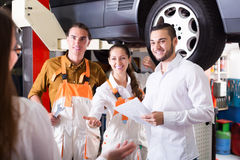 Client satisfied with mechanics renewal Stock Photography