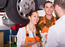 Client satisfied with mechanics renewal Stock Images