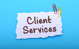 Client Services hand written on Paper closeup Stock Photography