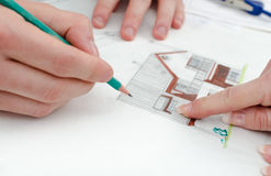 Client showing a detail on house plan Royalty Free Stock Photography