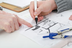 Client showing a detail on house plan Stock Photos