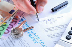 Client Signing A Mortgage Loan Agreement Rear View Stock Images