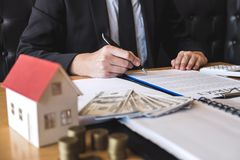 Client signing agreement contract real estate with approved application form, buying or concerning mortgage loan offer for and. House insurance royalty free stock images