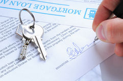 Client signing a mortgage loan agreement Stock Images