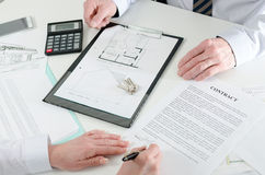 Client signing a real estate contract. In real estate agency Stock Images