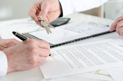 Client signing a real estate contract. In real estate agency Royalty Free Stock Image