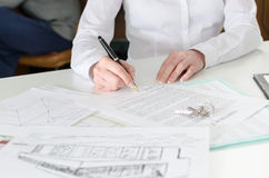 Client signing a real estate contract. In real estate agency Royalty Free Stock Photo