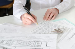 Client signing a real estate contract. In real estate agency Royalty Free Stock Photography