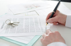 Client signing a real estate contract Stock Image