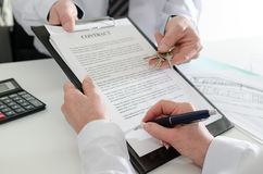 Client signing a real estate contract. In real estate agency Royalty Free Stock Photos