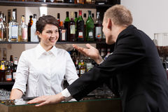 Client talking with girl bar. Handsome client talking with cute girl bar Stock Images
