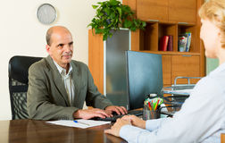 Client talking with notary Stock Images