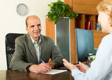 Client talking with notary Royalty Free Stock Photos