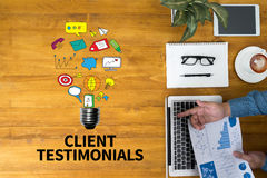 CLIENT TESTIMONIALS. Businessman working at office desk and using computer and objects, coffee, top view, with copy space Royalty Free Stock Photography