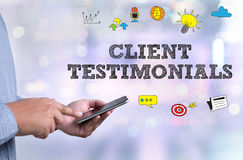 CLIENT TESTIMONIALS. Person holding a smartphone on blurred cityscape background Royalty Free Stock Photo