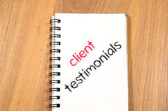Client testimonials text concept on notebook. Client testimonials news text concept write on notebook Royalty Free Stock Image