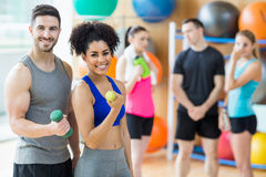 Client and trainer smiling at camera. At the gym Royalty Free Stock Images