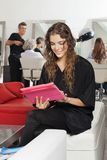 Client Using Tablet With Hairdresser And Women In Royalty Free Stock Image