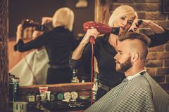 Client visiting hairstylist Stock Image