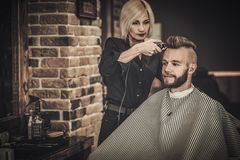 Client visiting hairstylist Royalty Free Stock Photos