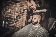Client visiting hairstylist Stock Photo