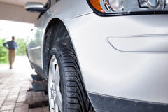 Client waiting while his car is being inspected in a garage Stock Photography