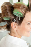 Client Wearing Hair Curlers Royalty Free Stock Photos