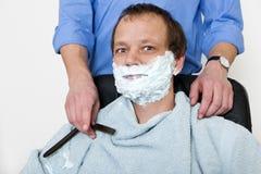Cliente dei barbieri fotografia stock