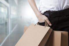 Cliente e sacchetti della spesa fotografia stock libera da diritti