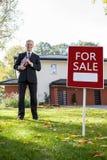 Clientes de espera do agente imobiliário Fotografia de Stock Royalty Free