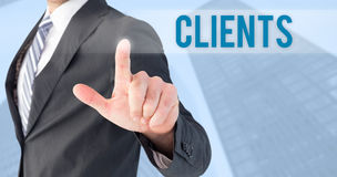 Clients against skyscraper. The word clients and businessman pointing with his finger against skyscraper stock photography