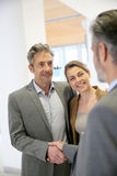 Clients and banking advisor handshaking Stock Photography