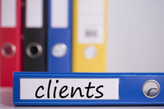 Clients on blue business binder. The word clients on blue business binder royalty free stock photography