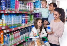 Clients with children choosing dairy products Stock Image