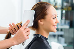 Clients hair being thoroughly brushed royalty free stock images