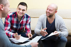 Free Clients Sitting With Papers And Smiling Royalty Free Stock Photo - 60763715