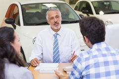 Clients talking with a dealer Stock Photo