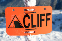 Cliff. A sign at a ski hill warning skiers of a cliff ahead royalty free stock images