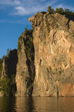 Cliff. High cliff at shore of Mazinaw Lake in sunset light Stock Photos