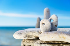 Cliff. Stones with the holes located on the sea cliff Stock Image